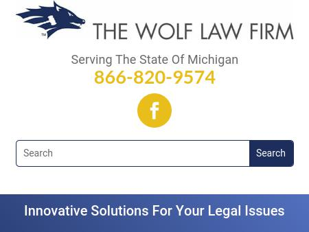 THE WOLF LAW FIRM